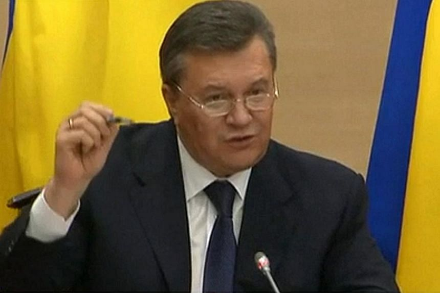 TV image showing deposed Ukrainian president Viktor Yanukovych speaking on Feb 28, 2014 in Rostov-on-Don. Mr Yanukovych, appearing in public for the first time since he was ousted, said he spoke by telephone to Russian leader Vladimir Putin afte