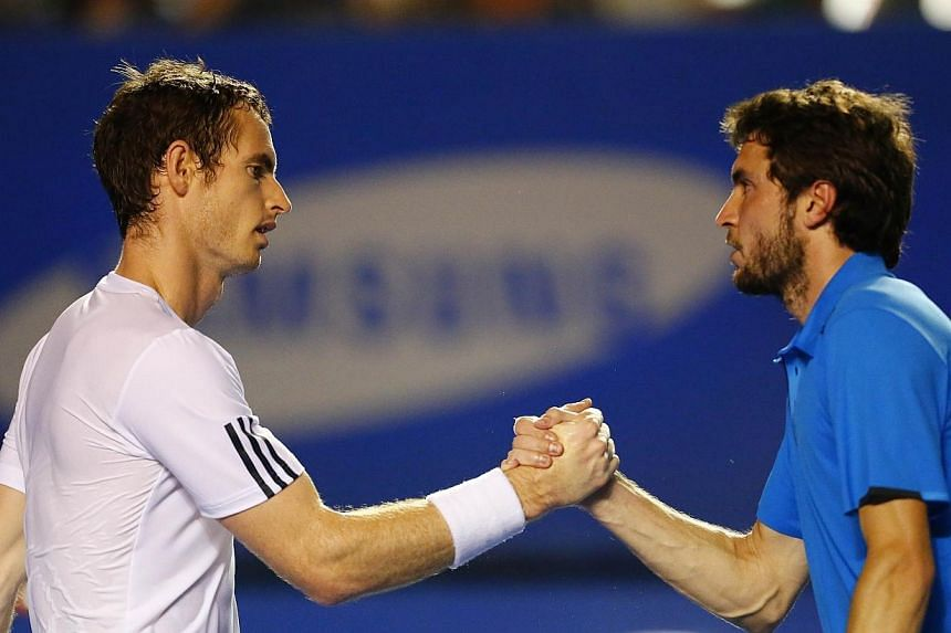 Andy Murray of Great Britain (left) shakes hands with Gilles Simon of France after his Mexico ATP Open men's singles tennis match, in Acapulco, Guerrero state, Mexico on Feb 27, 2014.Murray rallied from a set and a break down against Simon to a