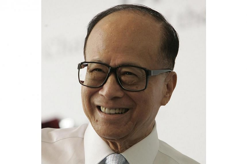 Influential Hong Kong tycoon Li Ka Shing on Friday, Feb 28, 2014, condemned a brutal attack on a veteran journalist and warned the territory will suffer serious harm if it loses press freedom. -- ST FILE PHOTO:EDWIN KOO