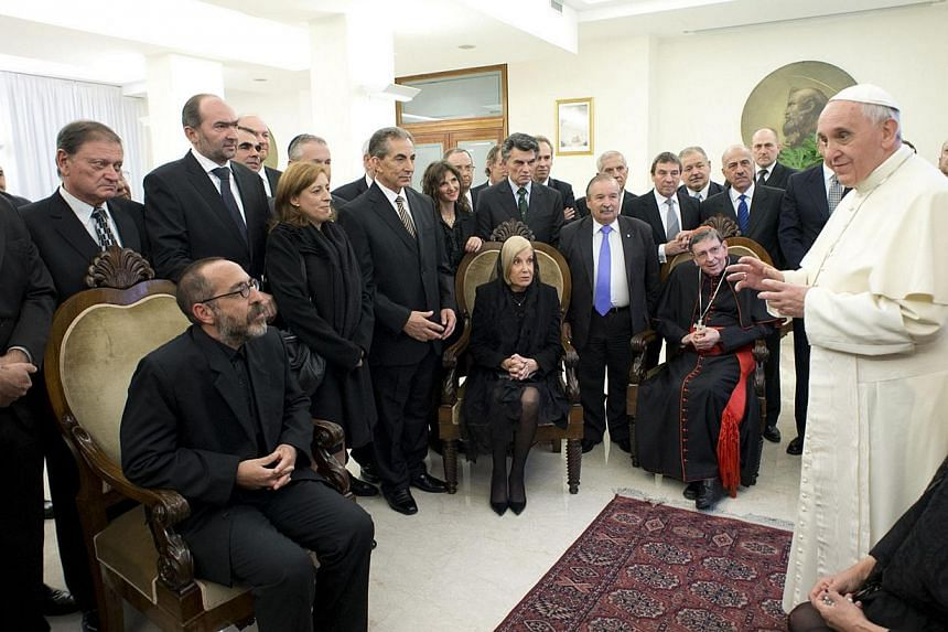 """Pope Francis talks to an Argentinian inter-religious group during a meeting at the Vatican, on Feb 27, 2014. Pope Francis on Friday, Feb 28, 2014, said couples whose marriages fail should be """"accompanied"""" and not """"condemned"""", wading into a debate on"""