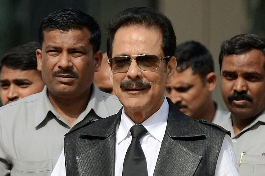 India's Sahara group's chairman Subrata Roy (centre), surrounded by bodyguards, leaves the Securities and Exchange Board of India (SEBI) head office in Mumbai, on April 10, 2013. The head of India's giant Sahara group surrendered to police on Friday,