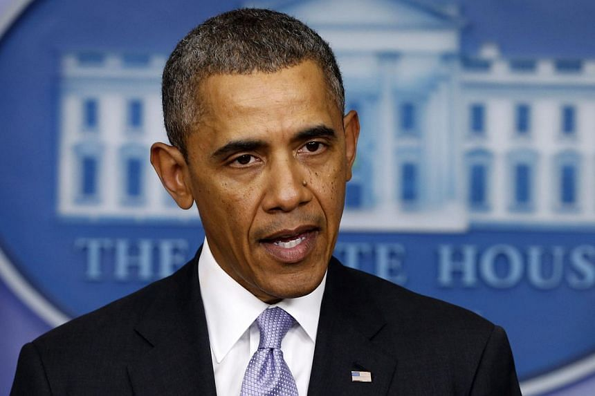 US President Barack Obama delivers remarks on the situation in Ukraine from the press briefing room at the White House in Washington, on Feb 28, 2014.-- PHOTO: REUTERS