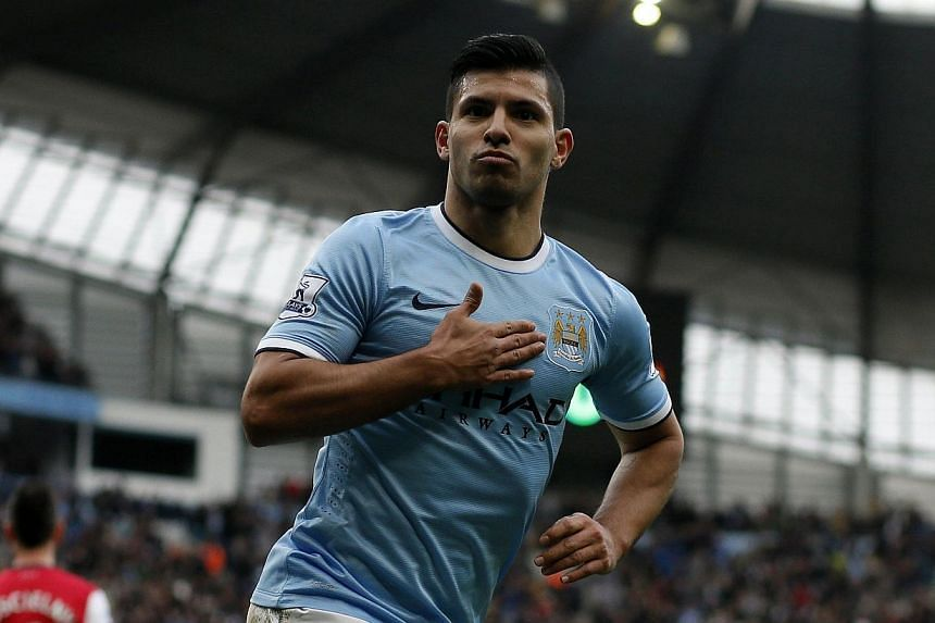 Manchester City's Sergio Aguero celebrates his goal during their English Premier League soccer match against Arsenal at the Etihad stadium in Manchester, northern England, on Dec 14, 2013.Manchester City manager Manuel Pellegrini has revealed A