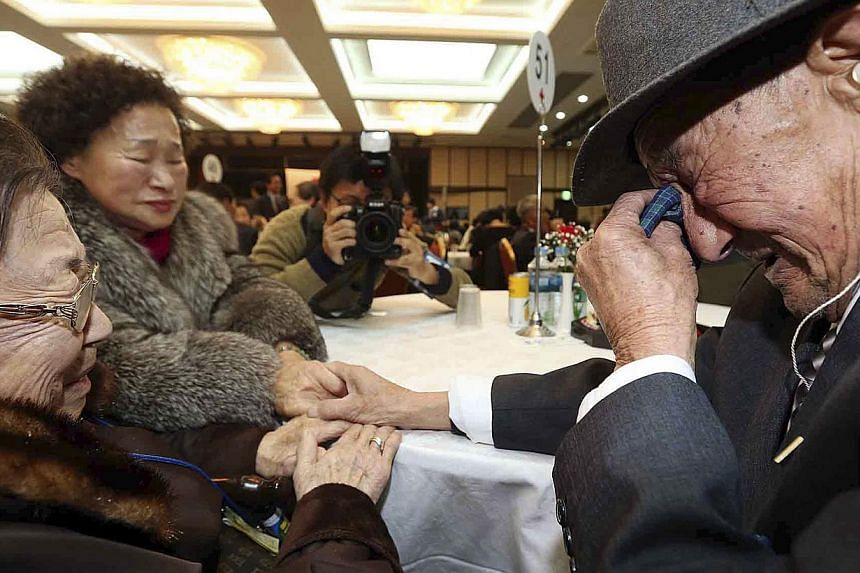 South Korean Lee Oh-sun (left), 94, and her North Korean brother Cho Won Jae, 83, cry as they bid farewell after their three-day temporary family reunion at the Mount Kumgang resort in North Korea, on Feb 25, 2014. -- FILE PHOTO: REUTERS