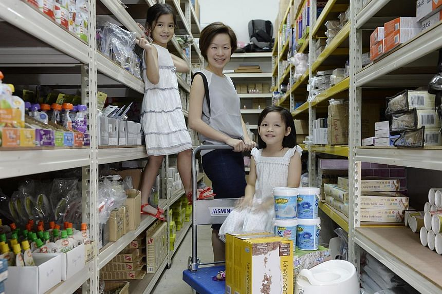 Ms Tan Su Ling and her daughters Vera (left), seven, and Nadya, five. Her company has done so well that she now employs five workers and has a 3,000 sq ft warehouse in Bukit Batok.