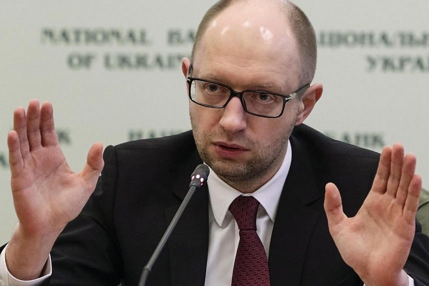 """Ukraine's new Prime Minister Arseny Yatseniuksaid on Saturday, March 1, 2014, his country would not be drawn into a military conflict by Russian """"provocations"""" in the Crimea region and appealed to Moscow to halt military movements there.-"""