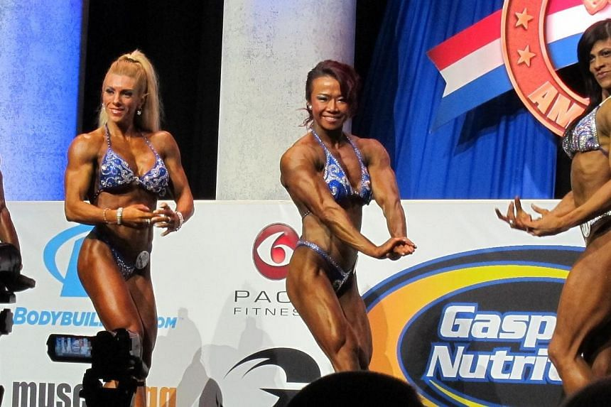 Singapore bodybuilder Joan Liew (centre) came out tops in the Women's Physique (Tall) category attempt at the Arnold Amateur International Bodybuilding, Fitness, Figure, Bikini and Physique Championships in Columbus, Ohio, on Friday, Feb 28, 2014. --