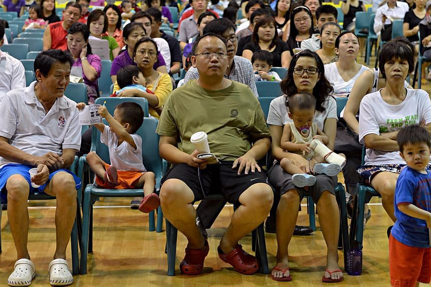 Parents and children at an Ministry of Education (MOE) roadshow,in Punggol View Primary School on April 1, 2013, toinform them of the five new MOE kindergartens. -- ST FILE PHOTO: NURIA LING