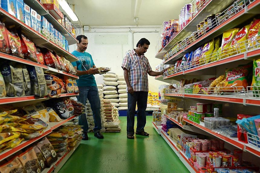 Workers shopping at the Sasco minimart in Jurong West. The store keeps prices low and provides free shuttle service from the workers' dormitories. On a busy weekend night, it can get more than 200 customers.