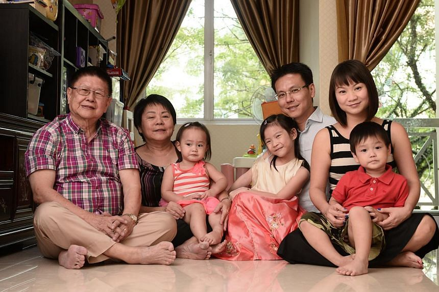 Mr Royce Lee (second from right) with his wife Sarah May (right), at home in their four-bedroom Bukit Timah condo unit with his parents (from left) Henry Lee and Jessie Lim, and children Annabeth, two, Christabelle, eight, and Oliver, three. -- ST PH