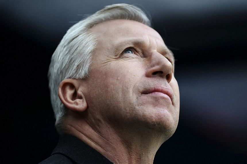 Newcastle United manager Alan Pardew attends their English Premier League soccer match against Manchester City at St James' Park in Newcastle, northern England, on Jan 12, 2014. -- FILE PHOTO: REUTERS