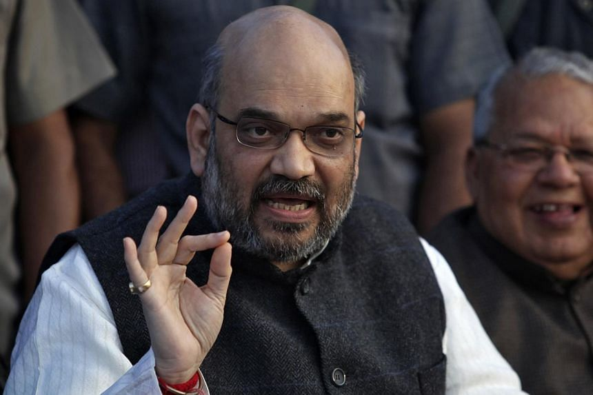 Mr Amit Shah, a leader of India's main opposition Bharatiya Janata Party (BJP), speaks during a news conference in the northern Indian city of Lucknow on March 1, 2014. -- PHOTO: REUTERS