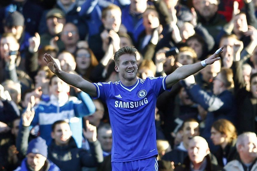 Chelsea's Andre Schurrle (cnetre) celebrates after scoring a hat trick against Fulham during their English Premier League soccer match at Craven Cottage in London on March 1, 2014. -- PHOTO: REUTERS