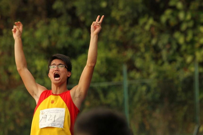 Chan Sheng Yao celebrates after setting a new national record at the Singapore Youth and Junior Championships at Bukit Gombak Stadium on Sunday, March 2, 2014.-- PHOTO: SINGAPORE ATHLETIC ASSOCIATION
