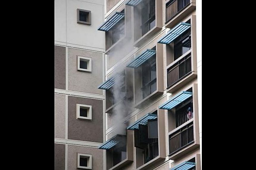 A fire broke out in a five-room flat at Block 512, Serangoon North Avenue 4, on Sunday evening. -- PHOTO: STOMP