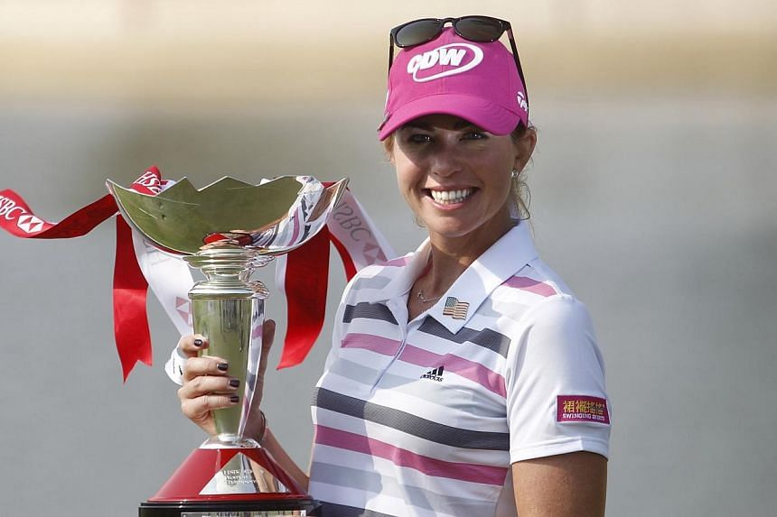 Paula Creamer of USA holds the trophy after winning the HSBC Women's Champions at Sentosa Golf Club on 2 Mar 2014. With a masterful eagle putt from 75 feet, Paula Creamer ended her four-year drought for a golf title when she won the 2014 HSBC Women's