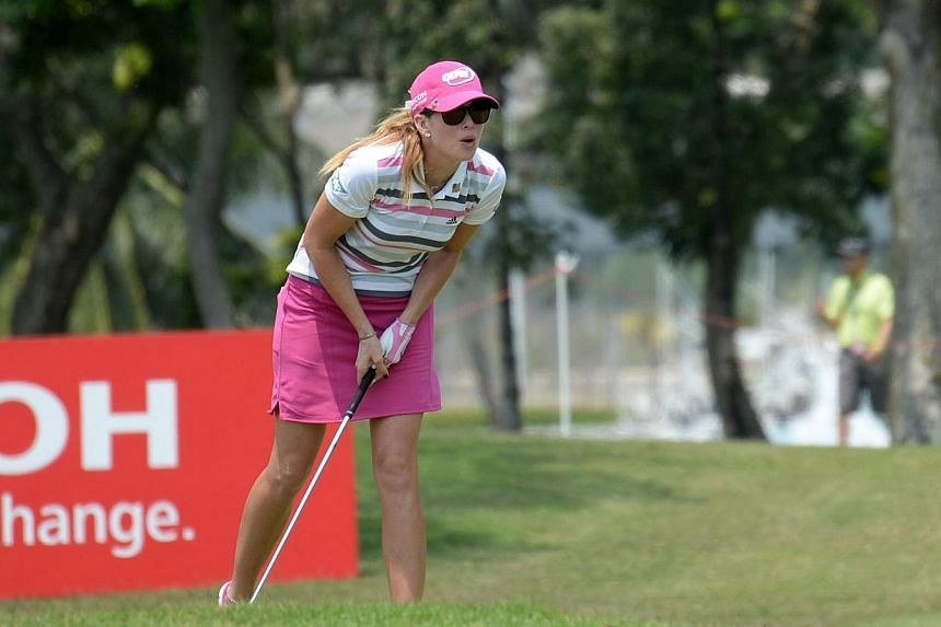 Paula Creamer of the US looks out for her shot during the final round of the 2014 HSBC Women's Champions golf tournament in Singapore on Mar 2, 2014. -- ST PHOTO: KEVIN LIM