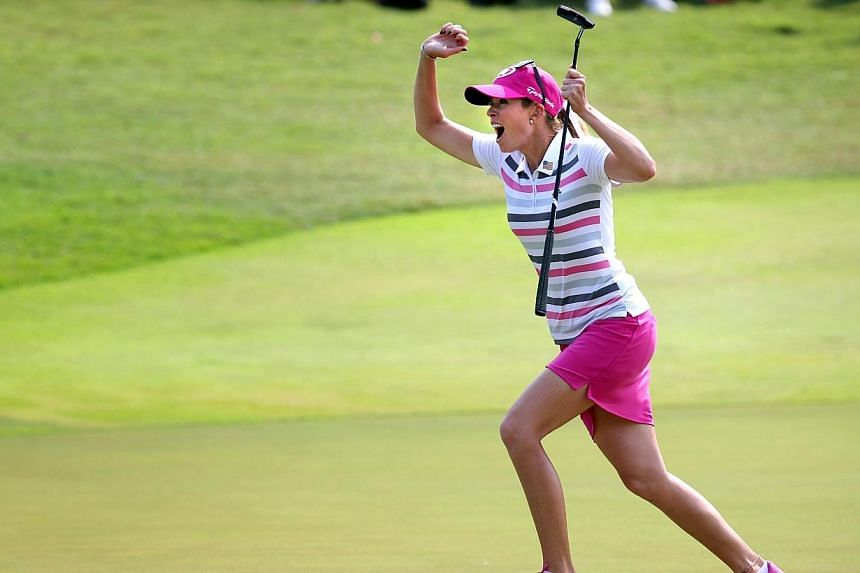 Paula Creamer of USA celebrates after sinking a birdie to win the HSBC Women's Champions at Sentosa Golf Club on 2 Mar 2014. -- ST PHOTO: KEVIN LIM
