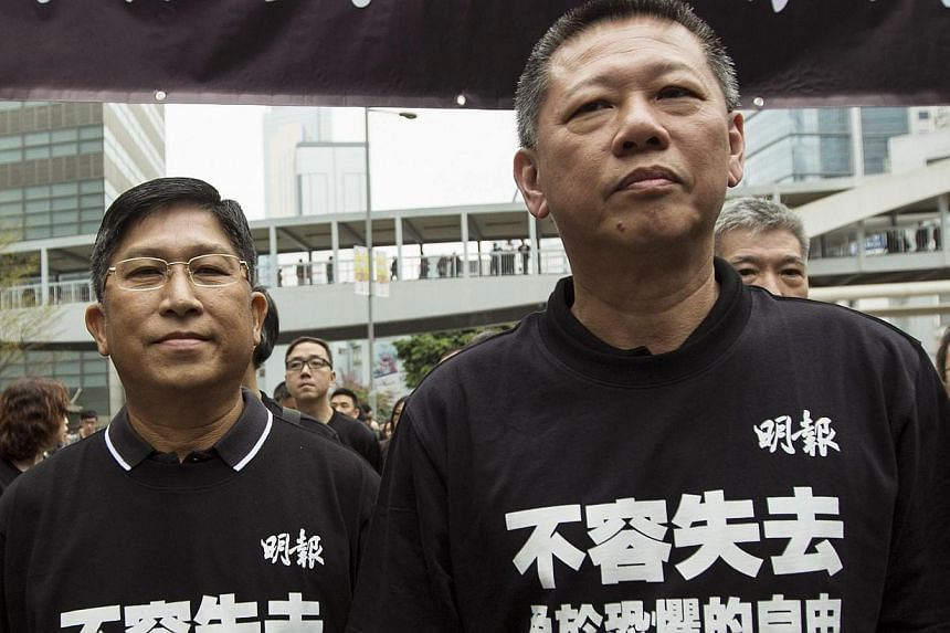 Ming Pao Chief executive editor Chong Tien Siong (left) and Media Chinese International Limited Executive Director & Group Chief Executive Officer Tiong Kiew Chiong, attend the march against violence on journalists in Hong Kong on Mar 2, 2014. --