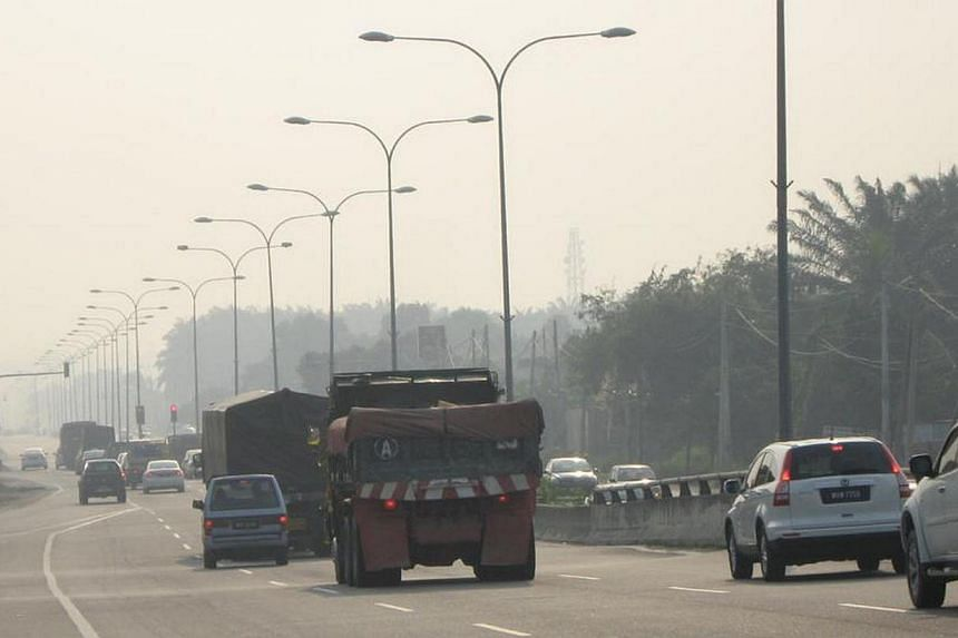 "Haze in Kelang. Singapore may have ""occasional slight haze"" for the next few days, especially in the mornings, said the National Environment Agency (NEA) in an advisory on Sunday night. -- PHOTO: SIN CHEW PUBLICATION"