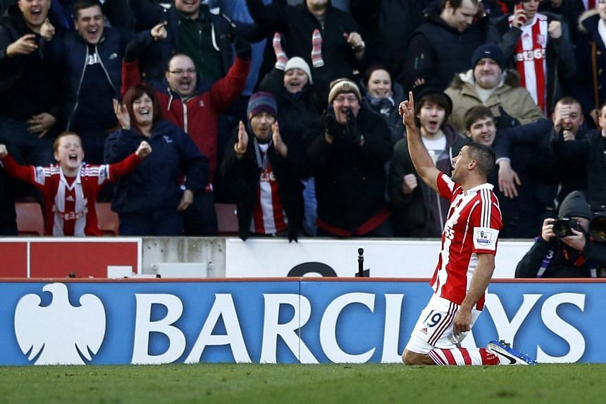 Stoke City's Jonathan Walters celebrates after scoring a penalty against Arsenal during their English Premier League soccer match at the Britannia stadium in Stoke-on-Trent, central England on March 1, 2014. -- PHOTO: REUTERS