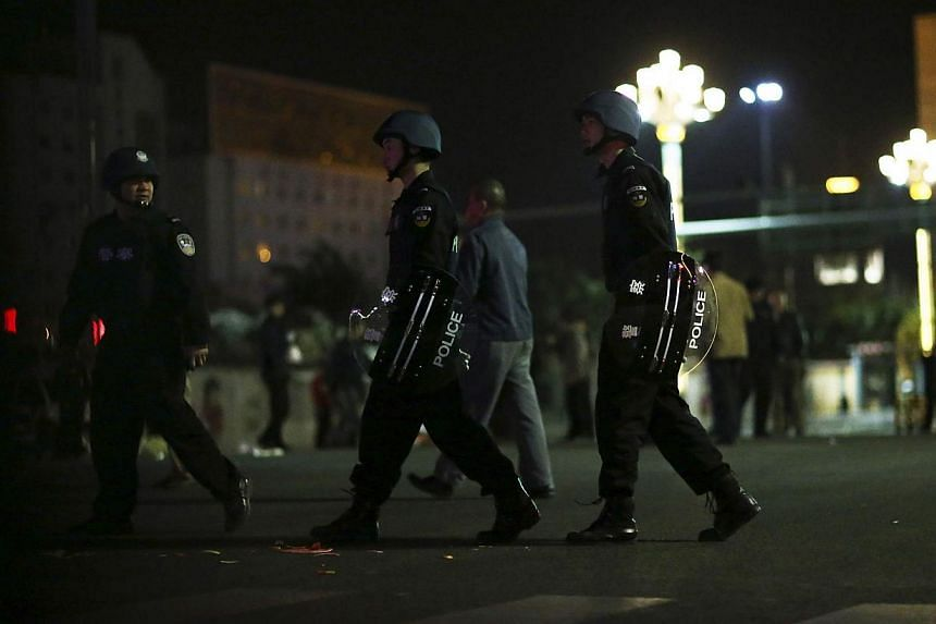 Police patrol on a street after a group of armed men attacked people at Kunming railway station, Yunnan province, on March 1, 2014. -- PHOTO: REUTERS