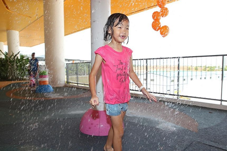 Ling Xin En, 6, plays at the water play area in the new 4-storey Ace the Place Community Club. -- ST PHOTO: SEAH KWANG PENG