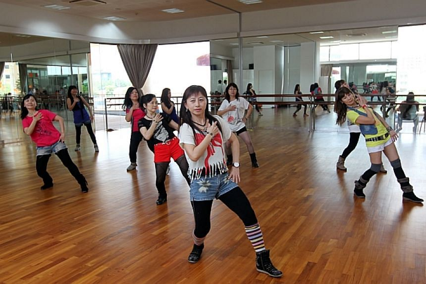Members of a folk dance group practise in the dance studio of the new 4-storey Ace the Place Community Club.-- ST PHOTO:SEAH KWANG PENG