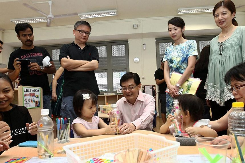 Education Minister Heng Swee Keat at openhouse of MOE kindergarten @ Da Zhong Primary School in Bukit Batok.Parents are happy with the facilities and the specially-designed teaching resource materials at the Ministry of Education (MOE) kinderga