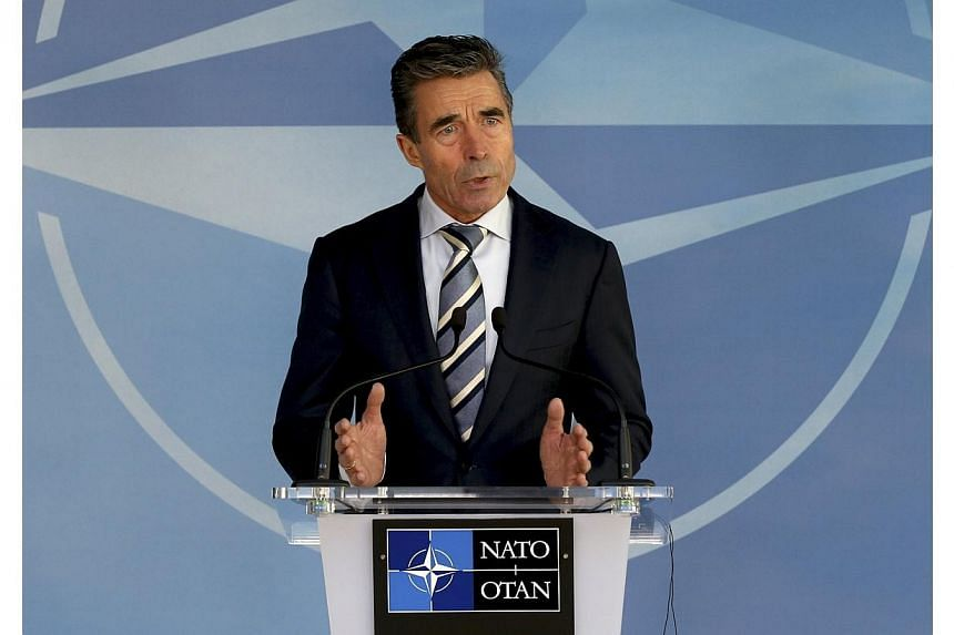 "Nato chief Anders Fogh Rasmussen urged Russia on Sunday, Mar 2, 2014, to stop its military activity and threats against Ukraine, saying Moscow's action threatened ""peace and security in Europe"". -- PHOTO: REUTERS"