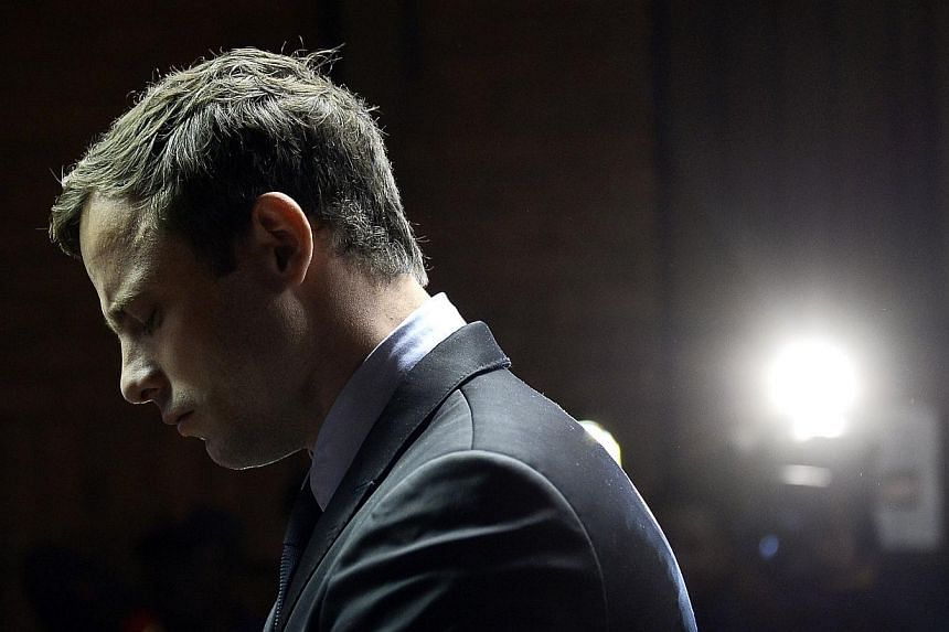 This photo taken on Aug 19, 2013 shows South African Paralympic sprinter Oscar Pistorius appearing at the Magistrate Court in Pretoria. Pistorius, who is charged with premediated murder for the killing of his lover Reeva Steenkamp, faces trial from M