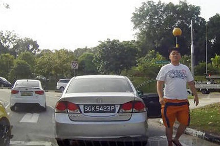 The  video showing   Quek's behaviour on the road went viral. He was later arrested.  The police launched an appeal for information after a cyclist was caught on camera taunting a driver along Thomson Road on Feb 10.