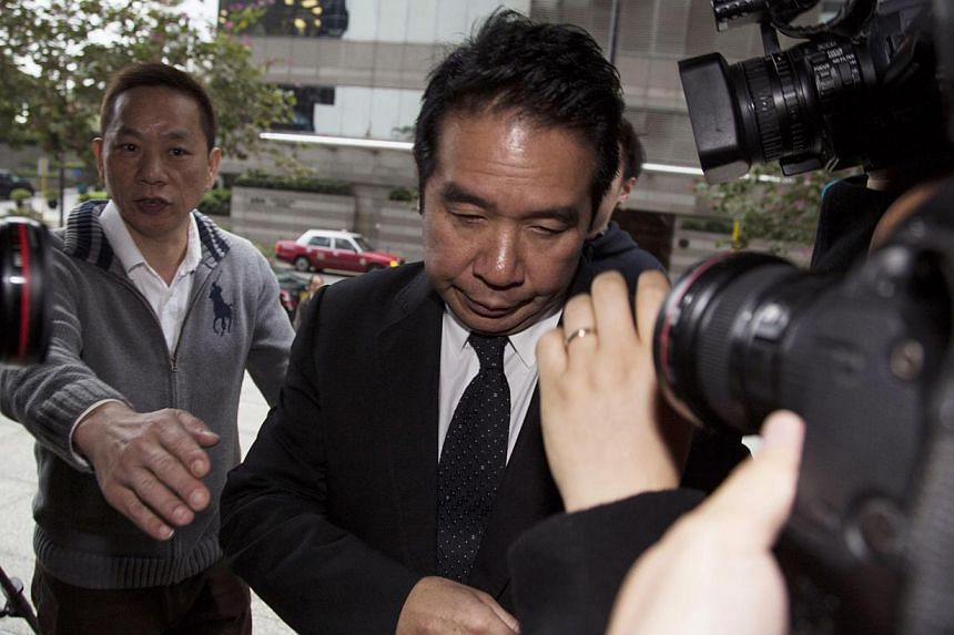 Former Birmingham City Football Club owner Carson Yeung arrived at a district court in Hong Kong on Feb 28, 2014. Yeung was on March 3, 2014 found guilty of three counts of money laundering by a Hong Kong court.-- FILE PHOTO: REUTERS