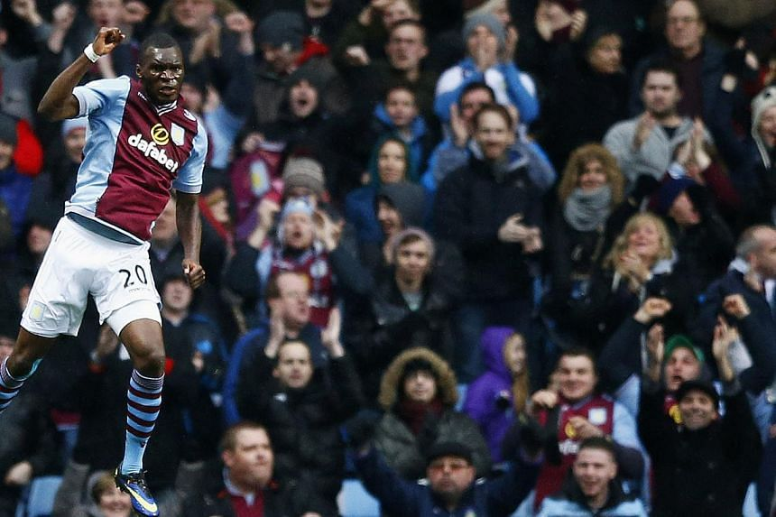 Aston Villa's Christian Benteke celebrates his first goal against Norwich City during their English Premier League soccer match at Villa Park in Birmingham, central England, on Mar 2, 2014. -- PHOTO: REUTERS
