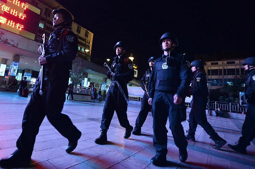 Chinese armed police patrol the scene of the terror attack at the main train station in Kunming, Yunnan Province on March 2, 2014. -- PHOTO: AFP