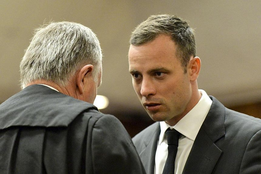 Oscar Pistorius arrives in court ahead of his trial at the North Gauteng High Court in Pretoria, on March 3, 2014. The trial of Olympian Oscar Pistorius began in Pretoria on Monday, March 3, 2014, with the star sprinter pleading not guilty to murderi