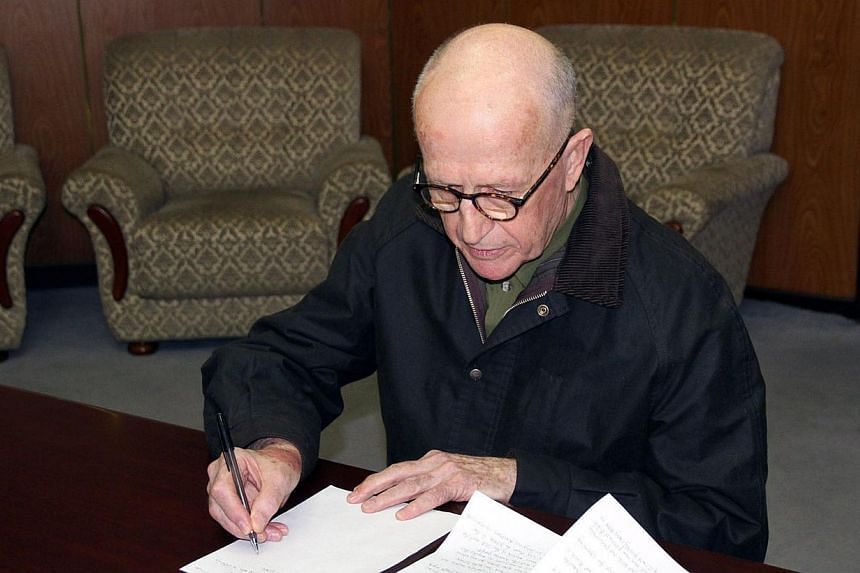 Australian missionary John Short, who was detained after distribution of religious pamphlets in a Bhuddhist temple in Pyongyang, makes an official apology at an undisclosed location in North Korea on March 1, 2014. -- PHOTO: AFP/KCNA via KNS