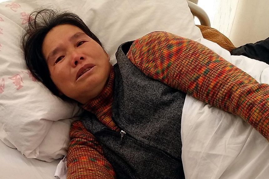 Madam Chen Guizhen, 50, speaking to The Straits Times from her hospital bed in Kunming on March 3. She witnessed her husband being hacked to death by assailants at a train station on March 1. The Chinese government has labelled the incident a terror