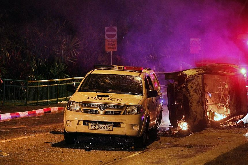 One of the several vehicles which were burnt during the Little India riot on Dec 8, 2013. The public hearings into the Little India riot will resume on March 4, 2014, after the Committee of Inquiry granted the State Counsel's application for adjournm