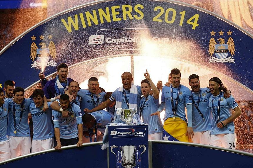 Manchester City celebrate winning their English League Cup final soccer match against Sunderland at Wembley Stadium in London on Mar 2, 2014. -- PHOTO: REUTERS