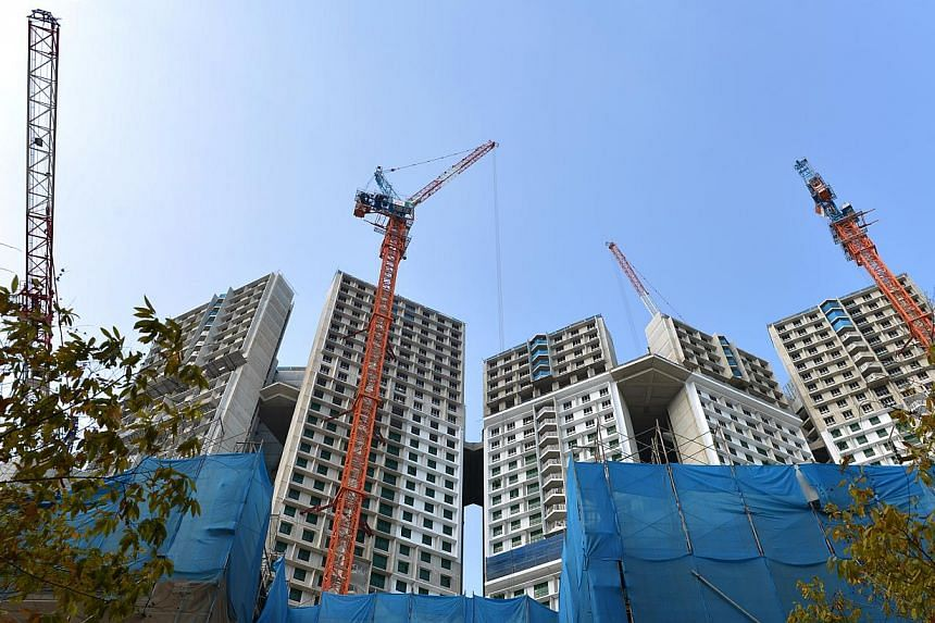 In a bid to nudge construction firms to boost productivity, the Government is mulling over whether to set a minimum quota for higher-skilled construction workers for each construction firm. -- ST FILE PHOTO: CAROLINE CHIA