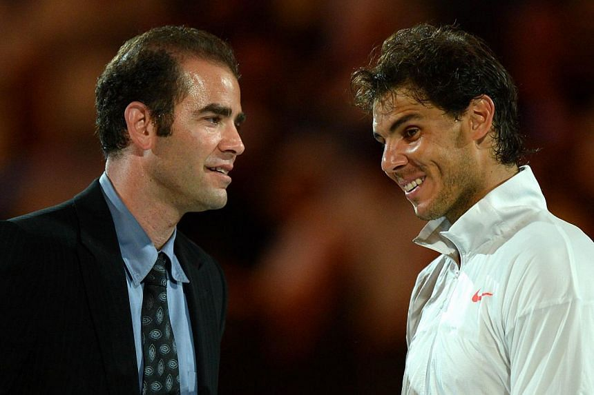 Spain's Rafael Nadal (right) shares a light moment with former champion Pete Sampras of the United States during a presentation ceremony on day fourteen of the 2014 Australian Open tennis tournament in Melbourne on Jan 26, 2014. World number one Rafa