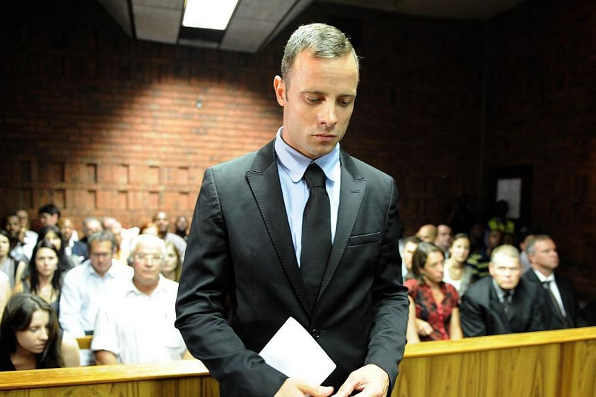 """South African Olympic sprinter Oscar Pistorius appearing at the Magistrate Court in Pretoria, on Feb 20, 2013. """"Blade Runner"""" Oscar Pistorius arrived at the Pretoria High Court on Monday, March 3, 2014, for the start of his murder trial, opening a de"""
