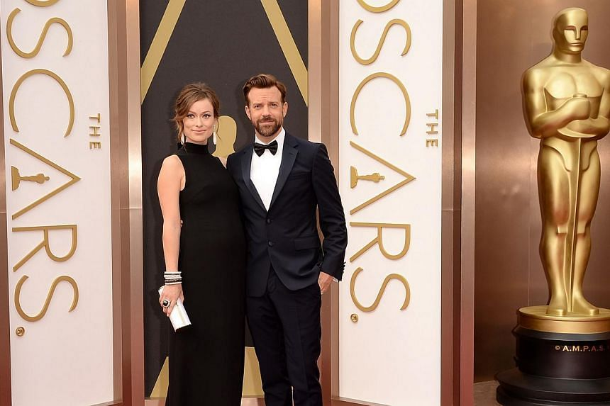 Actress Olivia Wilde (left) and Jason Sudeikis attends the Oscars held at Hollywood & Highland Center in Hollywood, California, on Mar 2, 2014. -- PHOTO: AFP