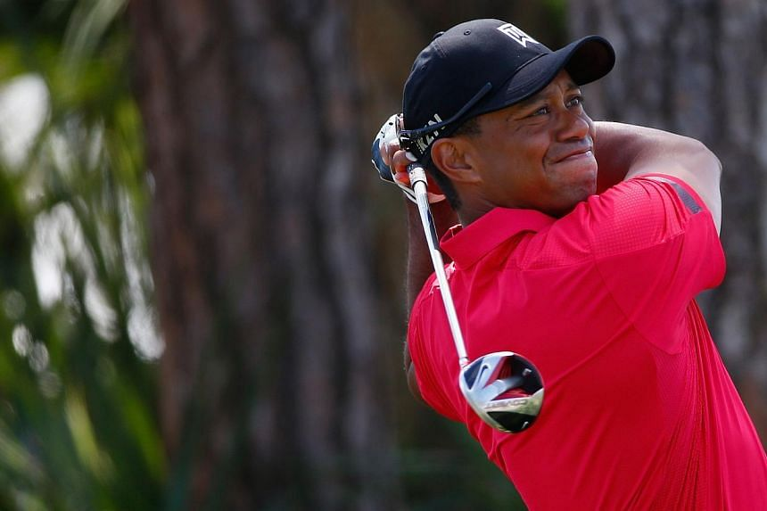 Tiger Woods plays a shot on the second hole during the final round of The Honda Classic at PGA National Resort and Spa on Mar 2, 2014 in Palm Beach Gardens, Florida. -- PHOTO: AFP