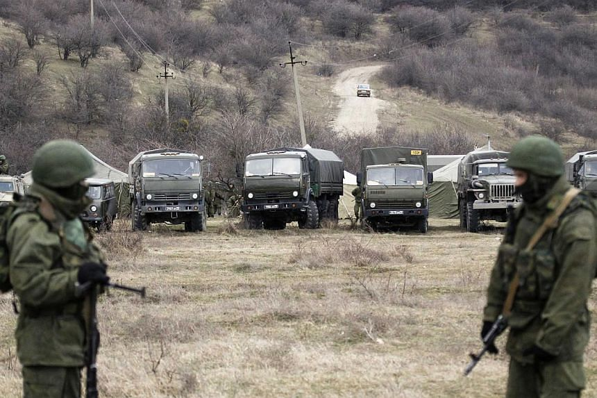 Military vehicles, believed to be property of Russian army, are seen near the territory of a Ukrainian military unit in the village of Perevalnoye outside Simferopol on Mar 2, 2014. -- PHOTO: REUTERS