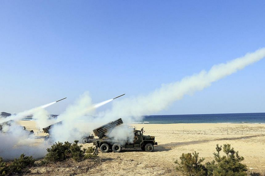 Rockets are launched from a K-136 multiple launch rocket system during a live-fire training exercise at a coast near the demilitarized zone (DMZ) which separates the two Koreas in Goseong, about 330 km north-east of Seoul, on March 3, 2014. -- PHOTO: