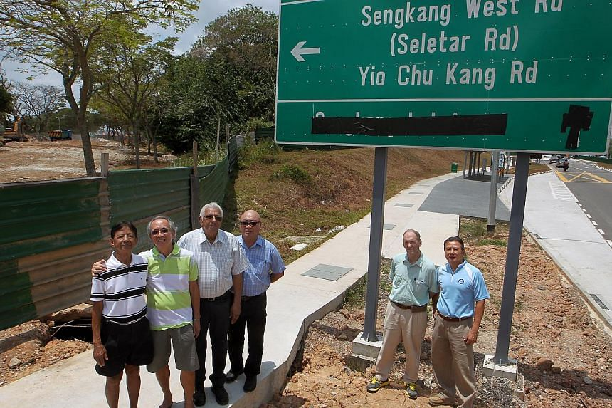 Seletar Hills residents (from left) George Pasqual, 80; Larry Kuah, 66; Percival Jeyapal, 62; Ronald Phua, 55; Bob McClure, 71; and John Phang, 61, standing next to Sengkang West Avenue. To the left is the stretch of Jalan Kayu Road that has been rem