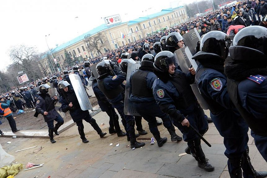Policemen try to stop pro-Russian activists stormng a local government building in Kharkiv on March 1, 2014. Ukraine's deposed president Viktor Yanukovych has formally asked Moscow to deploy Russian troops to re-establish law and order in his country