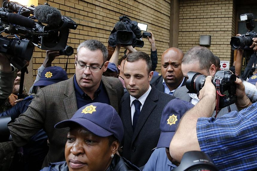 Oscar Pistorius leaves court after the second day of the trial of the Olympic and Paralympic track star at the North Gauteng High Court in Pretoria, March 4, 2014.More than 100,000 people had signed a petition on Tuesday, March 4, 2014, against